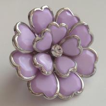 Silver tone stretchable with flower shape part on front side ring