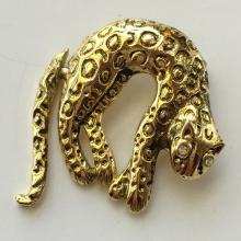 Gold tone panther with white rhinestones eyes and black enamel and moving tail pin brooch