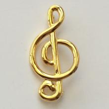Gold tone the Treble Clef pin brooch, signed AK