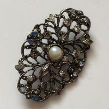 Blackened metal oval shape blue rhinestones brooch