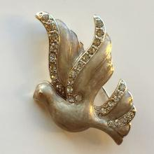 Silver tone DOVE shape pin brooch with enamel and white rhinestones, signed MONET