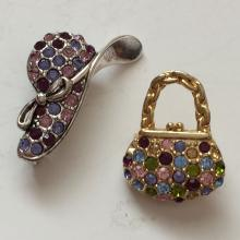 Lot of 2 vintage gold plated and silver tone brooches in shape of hat and purse with multicolor rhinestones