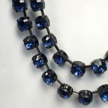 Two lines of blackened metal cups with four prongs set blue round rhinestones and lobster claw clasp necklace, signed CHICO'S