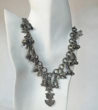 Silver tone chain with numerous dangling charms