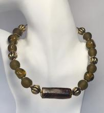 Smokey quartz color frosted and shiny, gold color beads covered with gold plated wire necklace