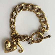 Gold plated Cuban link toggle clasp bracelet with puffy heart and J letter charms, signed JUICY COUTURE