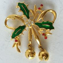 Gold plated brooch pin with enamel and rhinestones in shape of bow and leaves