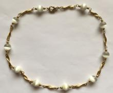 Gold plated chain with lobster clasp and cat eye white round beads necklace