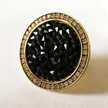 Gold plated black crystals and prongs set white crystals all around fancy ring, size 6 3/4