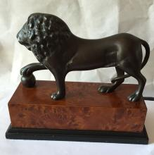 Bronze Lion Statue on marble wood color brick attached to black color painted rectangular flat wood
