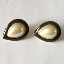 Gold plated pear shape faux white mother of pearl cabochon surrounded by black enamel push back earrings