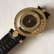 Gold plated round shape VISAGE Quartz watch with floating crystals and rhinestones and genuine leather black color band