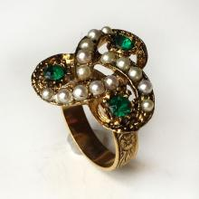 Gold plated ring with round faceted emerald color stones and white faux pearls ring