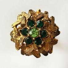 Gold plated textured ring with green rhinestones