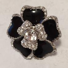 Rhodium plated enameled ring with white rhinestones in shape of flower, signed LIA SOPHIA