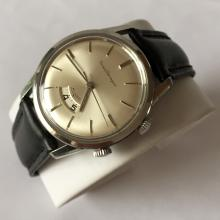 Vintage  Girard Perregaux Alarm, Swiss with rotating second wheel stainless steel round watch with genuine leather strap