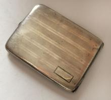 Antique sterling silver cigarette case engraved with lines on one side with rectangular plain space left for personal engraving. It is empty