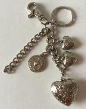 Silver tone key ring with puffy heart shape charms and chains, signed KATHY Van Zeeland