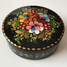 Round black plastic box, trinket with colorful enameled floral design on top and from sides, made by company SAPFIR in Ukraine