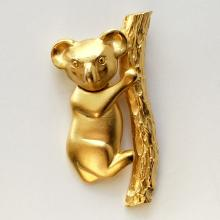 Gold plated satin finish Koala shape with moving body pin brooch, signed M.J.ENT