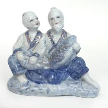 Porcelain blue, white and gold color figurine statuette