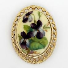 Gold plated oval shape pin brooch with enameled picture of flowers covered with protective colorless layer