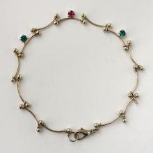 Silver tone flexible tiny lobster claw clasp anklet with green and red prongs set rhinestones