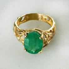 14k yellow gold oval shape genuine 6.06 ct Colombian emerald ring. Size 8 1/2