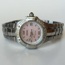 Stainless steel ladies round SEIKO COUTURA Date watch with bracelet