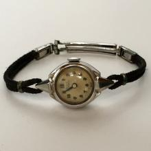 Vintage ladies GIRARD PERREGAUX Swiss gold filled watch with original black rope bracelet and gold filled clasp