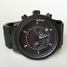 Stainless steel men's MICHAEL KORS watch with rubber bracelet and black dial