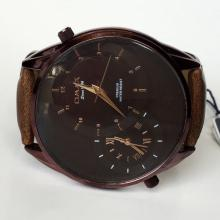Brown color round watch OMAX since 1946 Premium water resist with leather band and black dial