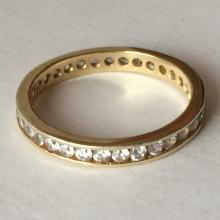 Gold plated sterling silver eternity ring band with channel set white CZ all around