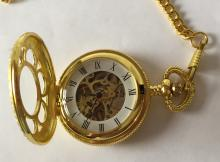 Gold plated round skeleton pocket watch with nice cover on front and chain