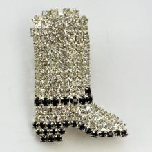 Silver tone Boot shape brooch with prongs set black and white rhinestones