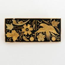 Gold plated rectangular pin brooch with diamond cut on black base flowers and bird