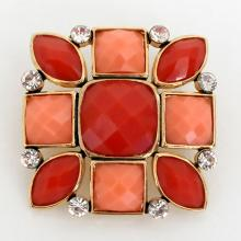 Gold tone square pin brooch with checkerboard cut red and pink coral color stones and white rhinestones