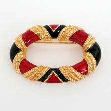 Gold plated textured oval shape pin brooch with red and black enamel