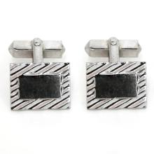Vintage rectangular sterling silver cufflinks with diamond cut design on front