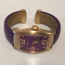Satin finish gold plated fancy Quartz watch with purple color dial and leather band, signed CHICO'S