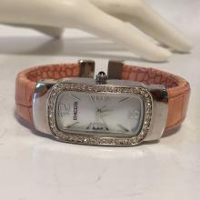 Rhodium plated rhinestones bezel and mother of pearl dial and leather band Quartz watch, signed CHICO'S