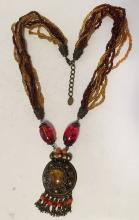 Multi color and multi strands cream and brown color beads necklace with amber color beads and genuine Amber pendant