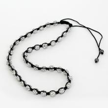 Shambala necklace with heavy silver tone metal round beads with white rhinestones and black rope