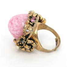 Vintage gold tone dome ring with rhinestones faux pearl and pink stone size adjustable.