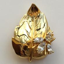 Gold plated brooch pin LEAF WITH BUG shape with white rhinestones