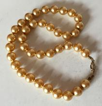 Golden color round faux knotted pearls necklace with silver tone fish shape clasp