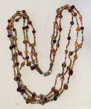Three lines necklace with different shapes and colors beads with clasp