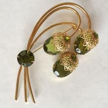 Prong set peridot color stones gold plated brooch / pin, signed Saran.cov