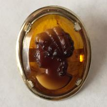 Vintage caved from amber oval shape cameo set in oval silver color frame brooch / pin, no hallmarks