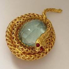 Gold tone snake oval aqua color stone filigree brooch